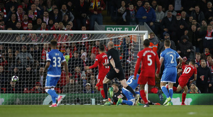 Liverpool's Philippe Coutinho scores their first goal