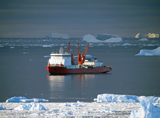 Progress station, Antarctica  January 10, 2017: Cargo ship arrives in port for unloading on an ice floe. Antarctic.