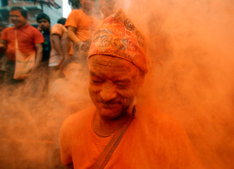 """A devotee smeared in vermillion powder is pictured while celebrating the """"Sindoor Jatra"""" vermillion powder festival at Thimi, in Bhaktapur"""