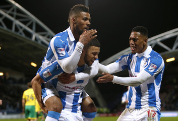Huddersfield Town's Nahki Wells celebrates with teammates after he scores his sides third goal