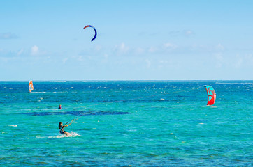 Professional kiter makes the difficult trick on a beautiful background, Mauritius