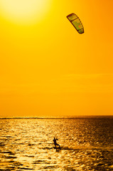 Professional kiter makes the difficult trick on a beautiful background of sunset, Mauritius