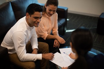 High angle view of businessman discussing with female colleagues