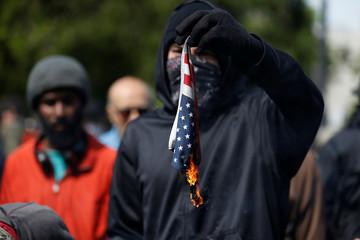 Demonstrators for and against U.S. President Donald Trump rally in Berkeley, California