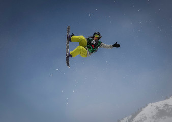 An athlete soars during Gorilla Winter Jungle snowboarding and freestyle skiing festival at ski resort Shimbulak outside Almaty, Kazakhstan