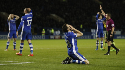 Sheffield Wednesday's William Buckley and teammates look dejected