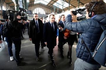Emmanuel Macron, head of the political movement En Marche !, or Onwards !, and candidate for the 2017 presidential election, arrives at the Gare du Nord railway station en route to deliver a speech in Lille