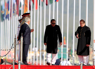 Pakistan's Prime Minister Nawaz Sharif and President Mamnoon Hussain arrive to attend the Pakistan Day military parade in Islamabad