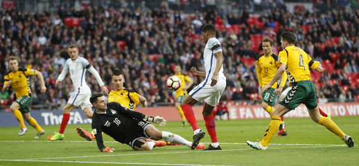 Lithuania's Ernestas Setkus saves from England's Marcus Rashford
