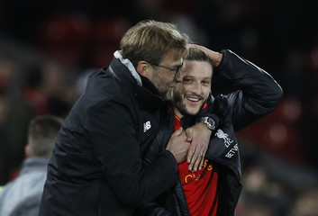 Liverpool manager Juergen Klopp celebrates after the game with Liverpool's Adam Lallana