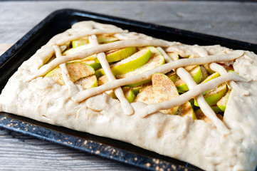 Preparing open pie or galette with apples