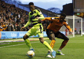 Wolves' Dominic Iorfa and Huddersfield's Rajiv van La Parra in action