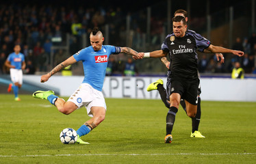 Napoli's Marek Hamsik in action with Real Madrid's Pepe