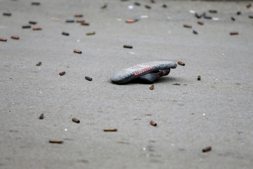 A slipper is seen amid bullet casings in the Ain el-Hilweh Palestinian refugee camp in southern Lebanon