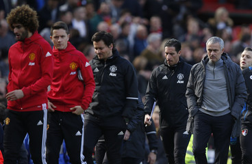 Manchester United manager Jose Mourinho walks out before the match
