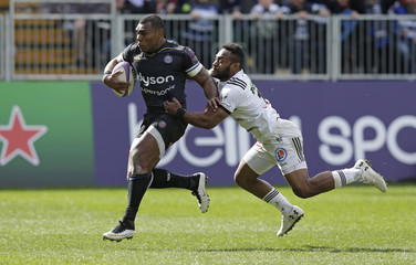 Semesa Rokoduguni of Bath Rugby is tackled by Benito Masilevu of Brive