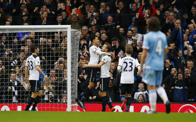 Tottenham's Dele Alli celebrates scoring their fourth goal with Harry Kane