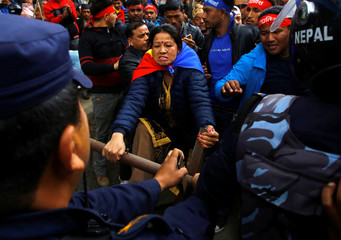 Hindu activists affiliated with Rastriya Prajatantra Party Nepal (RPP-Nepal) try to break through the barricade as they march towards the Election Commission in Kathmandu