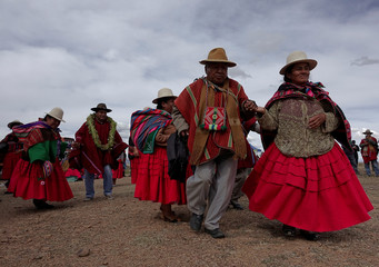 Farmers dance during a ceremony to promote sweet quinoa at the Canaviri district in La Paz