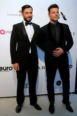 Singer Ricky Martin and his partner Jwan Yosef pose for photographers at the 2017 Elton John AIDS Foundation Academy Awards Viewing Party in Los Angeles