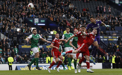 Hibernian's Ofir Marciano heads a shot at goal