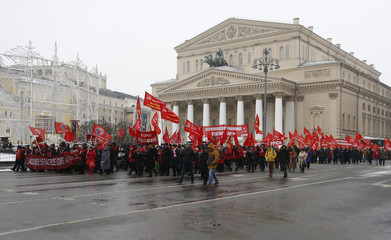 Supporters of Russian Communist Party take part in rally marking Defender of Fatherland Day, with Bolshoi Theatre seen in background, in central Moscow