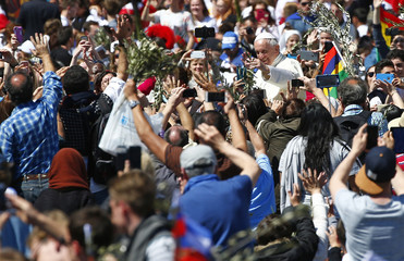 Pope Francis waves at the end of the Palm Sunday Mass in Saint Peter's Square at the Vatican