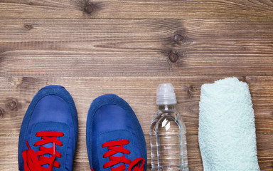 Sneakers, a towel and water
