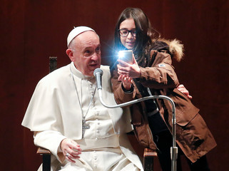 A girl takes a selfie with Pope Francis during a visit to the parish of St. Mary Josefa of the Heart of Jesus in Rome