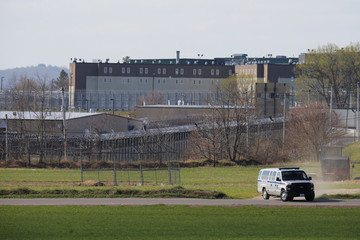 A prison van drives past the at the Souza Baranowski Correctional Center in Shirley where former New England Patriots player Hernandez was found dead in his jail cell