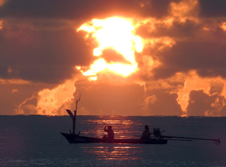 Fishermen anchor their boat at dawn off the coast of Koh Samui