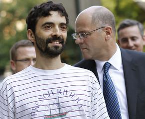 FILE PHOTO - Former Goldman Sachs computer programmer Aleynikov smiles as he exits Manhattan Criminal Court in New York