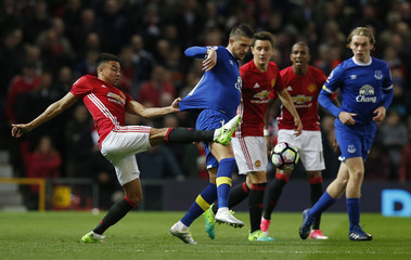 Manchester United's Jesse Lingard in action with Everton's Kevin Mirallas