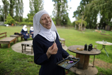 """California """"weed nun"""" Christine Meeusen, lights a joint at Sisters of the Valley near Merced"""