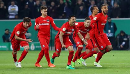 Eintracht Frankfurt's players celebrate winning the match after a penalty shootout