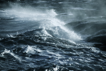 Big stormy ocean wave. Blue water background Wall mural
