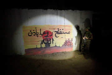 A view of Islamic State slogans painted along the walls of the tunnel that was used by Islamic State militants as an underground training camp in the hillside overlooking Mosul