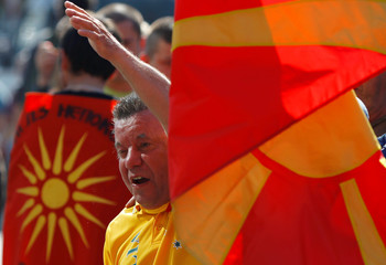 A protestor shouts slogans in front of the EU offices during a visit of The European Union's enlargement commissioner, Johannes Hahn in Skopje