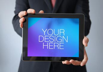 User Holding Up Tablet Mockup 1