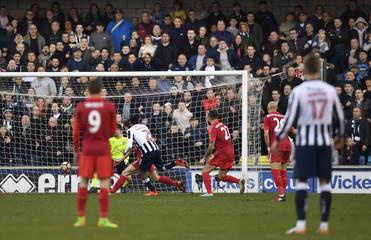 Millwall's Shaun Cummings scores their first goal