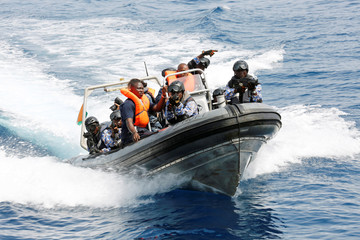 Members of the Ivory Coast Navy take part in a multinational naval exercise off the coast of Abidjan
