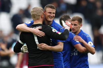 Leicester City's Kasper Schmeichel and Robert Huth celebrate at the end of the game