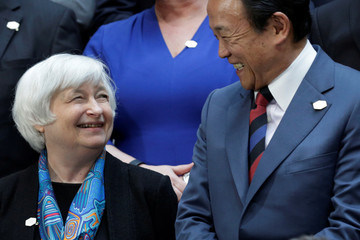 Federal Reserve Chair Janet Yellen and Japanese Finance Minister Taro Aso smile before G-20 family photo during the IMF/World Bank spring meetings in Washington