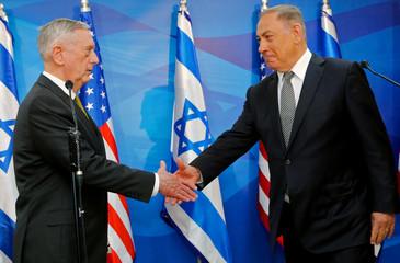 Israel's Prime Minister Benjamin Netanyahu welcomes U.S. Defense Secretary James Mattis in his offices in Jerusalem