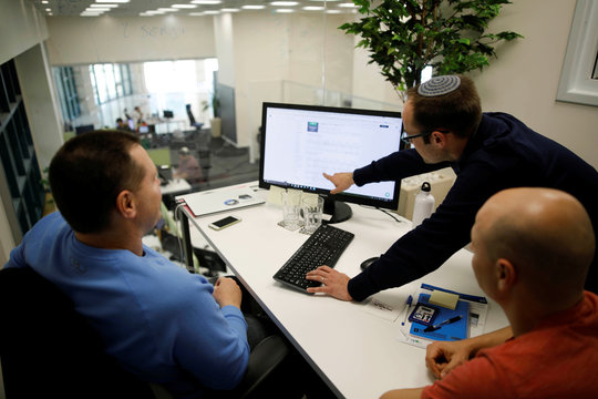 Employees at Freightos, an online marketplace for international shipping, work at their offices in Jerusalem