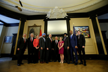U.S. Homeland Security Secretary Kelly takes part in a group photo with Canadian cabinet ministers on Parliament Hill in Ottawa