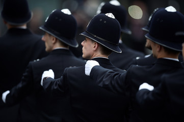 New Police recruits take part in a passing-out parade at the Metropolitan Police Academy in London