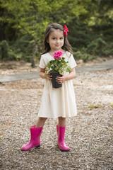 Little Hispanic girl with flowers