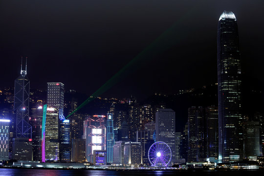 Laser light beams as buildings in the financial Central district are lit up before Earth Hour in Hong Kong