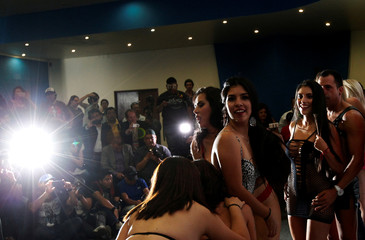 """Exotic models and actors pose for photographs at a news conference to promote the """"Expo Sex and Eroticism"""" adult exhibition in Mexico City, Mexico"""
